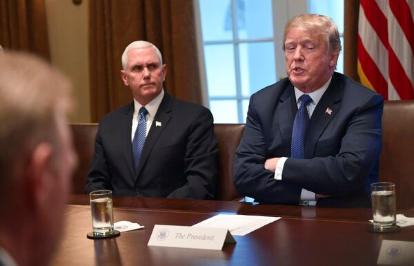 President Donald Trump, right, sitting next to Vice President Mike Pence, left, speaks in the Cabinet Room of the White House in Washington, Monday, April 9, 2018, at the start of a meeting with military leaders. (Susan Walsh/AP)