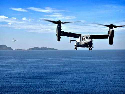 A U.S. Marine Corps MV-22 Osprey approaches the amphibious assault ship Wasp off the coast of the Philippine islands during Balikatan 2019. (Navy)