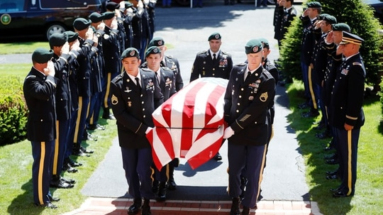Special Forces pallbearers carry the casket of retired Chief Warrant Officer 4 Christian McCoy, who died June 24, 2019, while working as a private contractor into Afghanistan, into St. Charles Church in Pittsfield, Mass., for his funeral July 9, 2019. (Stephanie Zolshan/AP via The Berkshire Eagle)