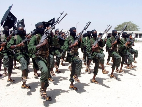In this Feb. 17, 2011, file photo, hundreds of newly trained al-Shabab fighters perform military exercises in the Lafofe area some 18 km south of Mogadishu, in Somalia. (Farah Abdi Warsameh/AP)