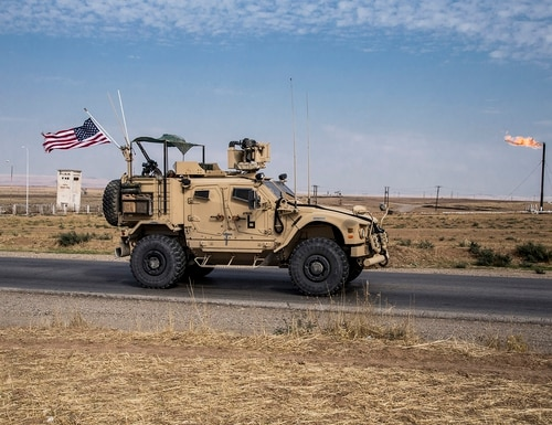 In this Oct. 28, 2019, file photo, U.S. forces patrol Syrian oil fields in eastern Syria. (Baderkhan Ahmad/AP)
