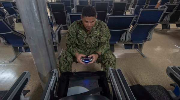 Information Systems Technician 2nd Class Emmanuel Velazquez plays a video game on Aug. 22 aboard the expeditionary fast transport vessel Spearhead while it sailed the Atlantic Ocean. (Mass Communication Specialist 3rd Class Maria I. Alvarez/Navy)