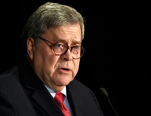 In this Feb. 10, 2020, photo, Attorney General William Barr speaks at the National Sheriffs' Association Winter Legislative and Technology Conference in Washington. Barr vowed in an interview with The Associated Press Tuesday, March 17, that there would be swift and severe action if a foreign government is behind disinformation campaigns aimed at spreading fear in the U.S. amid the coronavirus pandemic or a denial of service attack on the networks of the Department of Health and Human Services. (Susan Walsh/AP)