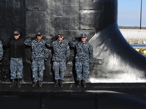 Sailors of Virginia-class Pre-Commissioning Unit Colorado salute in front of the sail during a rehearsal in preparation for Colorado's commissioning March 17. (MCC Darryl Wood/Navy)