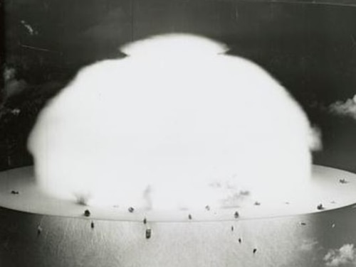 Mushroom cloud with ships below during Operation Crossroads nuclear weapons test on Bikini Atoll. (Library of Congress)