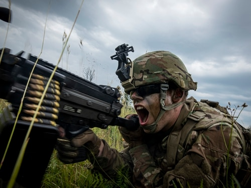 Pfc. Justin Harvey fires at objectives during tactical training at the Camp Grayling Joint Maneuver Training Center, Mich., during Northern Strike 19 in July. (Master Sgt. Matt Hecht/Army)