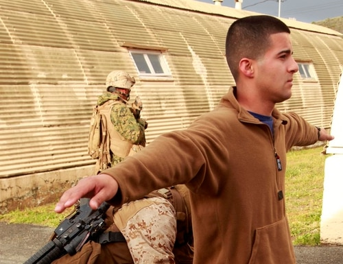 Lance Cpl. Rafael Montalvo, a role player acting as an American citizen, is being searched for dangerous items during a noncombatant evacuation operation training, April 11, 2012. After leaving the Marine Corps, Montalvo became an Illinois State Trooper in 2019. He was indicted on federal theft and conspiracy charges for allegedly stealing and selling stolen goods from MCAS Cherry Point, N.C. (Marine Corps)