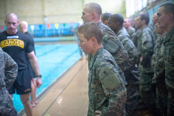 Male and female Ranger Training Assessment Course students demonstrate their knowledge of combat water survival techniques at the Briant Wells Gym indoor pool Jan. 24, 2015 during the Ranger Training Course Assessment at Fort Benning, Georgia. The combat water survival training included a 15-meter swim and a 3-meter blind drop into the water with combat equipment. (U.S. Army photo by Patrick A. Albright/Released)