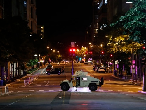 A military Humvee blocks an intersection along K Street in downtown Washington as demonstrators protest the death of George Floyd, Monday, June 1, 2020, in Washington. Floyd died after being restrained by Minneapolis police officers. (Alex Brandon/AP)