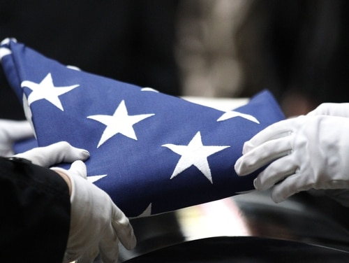 A seventh service member has died from COVID-19, according to Pentagon data. (AP Photo/Rick Bowmer)
