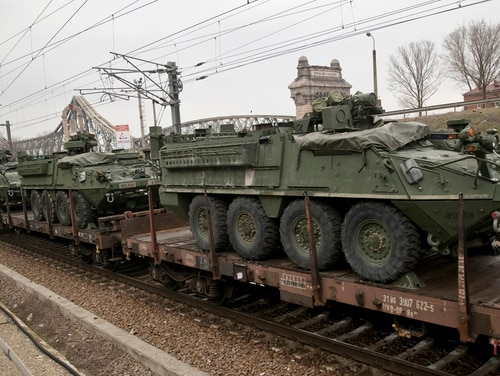 US military armored vehicles are transported on a freight train near the Black Sea port of Constanta, Romania, Sunday, March 15, 2015. According to local media and Romanian defense ministry the vehicles will take part in military exercises in the Black Sea region that started this weekend with NATO sea exercises involving ships USS Vicksburg, as well as a German auxiliary ship and frigates from Canada, Turkey, Italy and Romania.(Vadim Ghirda/AP)