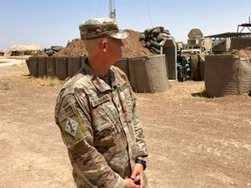 Col. Scott Desormeaux, who is with the Louisiana National Guard, talks to reporters in northern Syria during a visit by Marine Gen. Frank McKenzie, top U.S. commander for the Middle East. The Syria deployment is just one of many missions the Louisiana Guard had to juggle over the past year. (AP Photo/Lolita Baldor)
