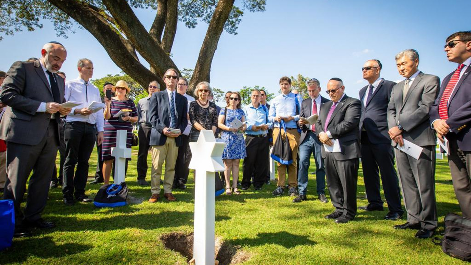 Living relatives, government officials and Operation Benjamin members gather for a rededication ceremony for five Jewish-American service members killed in action in World War II and buried under Latin Crosses at Manila American Cemetery in the Philippines, on Feb. 12, 2020. The nonprofit locates and rectifies cases of incorrect gravestones for deceased Jewish soldiers. (Courtesy of Operation Benjamin)