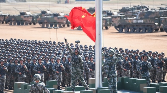 A new report released by the Defense Intelligence Agency assesses China's military capabilities. (Photo credit: STR/AFP/Getty Images)