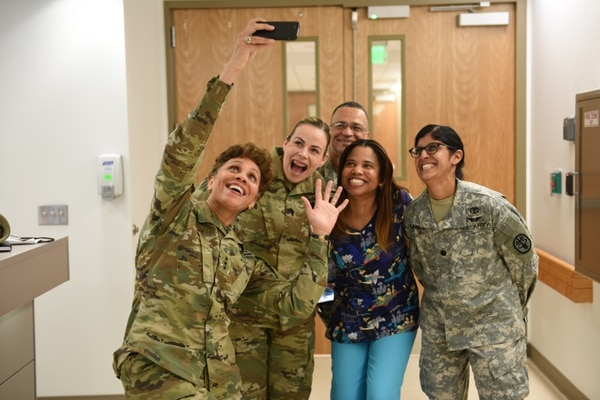 Lt. Gen. Nadja West, Army Surgeon General and commanding general, U.S. Army Medical Command, takes a selfie with some of the staff from Pediatrics at Womack Army Medical Center, Feb. 17. (Photo by Eve Meinhardt/WAMC PAO)