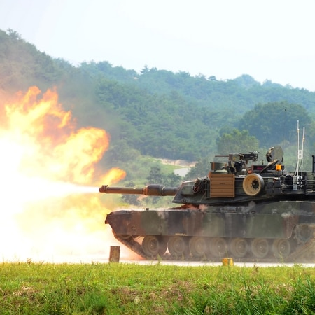 General Dynamics Land Systems has worked to put new power generation to additional survivability into the next evolution of its Abrams M1A2 tracked combat vehicle (shown firing live rounds during a joint military exercise between South Korea and the U.S.). (Park Ji-Hwan/AFP/Getty Images)