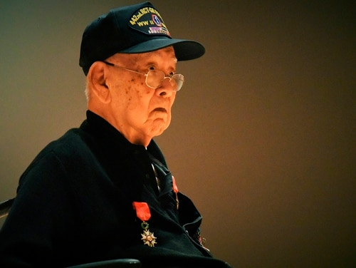 World War II veteran Kenneth Higashi wears the French Legion of Honor Medal on his sweater after ceremonies on Friday in Spearfish, S.D. (Jim Holland/Rapid City Journal via AP)