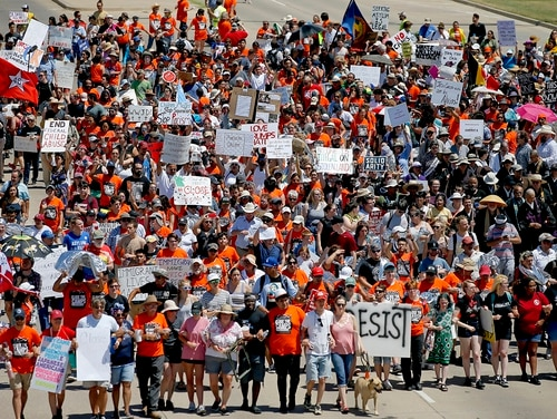 In this July 20, 2019, file photo, protesters march outside Fort Sill in protest of plans to place migrant children at the Army post in Lawton, Okla. (Bryan Terry/The Oklahoman via AP)