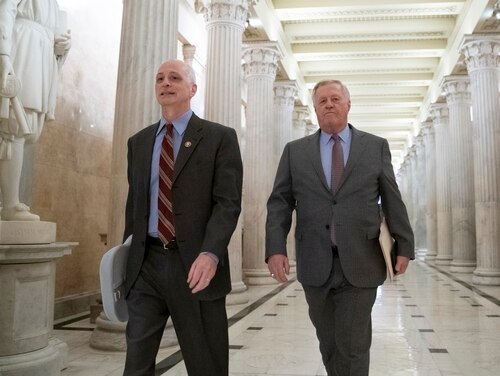 House Armed Services Committee Chairman Adam Smith, D-Wash., left, and House Agriculture Committee Chair Collin C. Peterson, D-Minn., walk through the Capitol on March 27, 2019. (J. Scott Applewhite/AP)