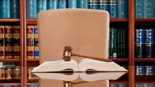 Administrative law judges are expected to issue at least 500 decisions a year, a metric that has proven difficult to meet in the many years since its introduction. (Spiderplay/Getty Images)