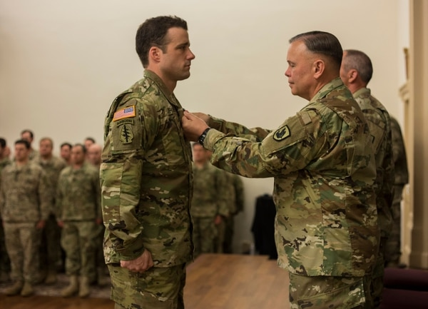 Staff Sgt. Michael Sargent, Alpha Company, 1st Battalion, 19th Special Forces Group, is recognized with the Silver Star Medal during an award ceremony on April 29, 2016 in Tacoma, Washington. Staff Sgt. Sargent distinguished himself by completely exposing himself without hesitation to extremely close enemy fire in order to secure a fallen Afghan commando and recover a fallen soldier to safety during combat action in Afghanistan on December 17, 2015. (U.S. Army National Guard photo by Sgt. 1st Class Jason Kriess)