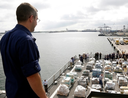 Pallets containing more than 26 tons of cocaine worth at least $715 million sit on the flight deck of of 418-foot Coast Guard Cutter Hamilton, Thursday, Dec. 15, 2016, in Fort Lauderdale, Fla. The cocaine was brought ashore Thursday following multiple recent seizures by the U.S. Coast Guard and the Royal Canadian Navy in the eastern Pacific. (AP Photo/Lynne Sladky)