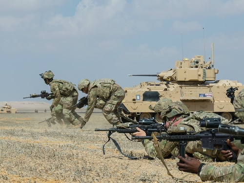 Soldiers assigned to the 155th Armored Brigade Combat Team, Task Force Spartan, bound toward an objective during a rehearsal for a live-fire exercise near Alexandria, Egypt, Sept. 10, 2018. (Sgt. James Lefty Larimer/Army)