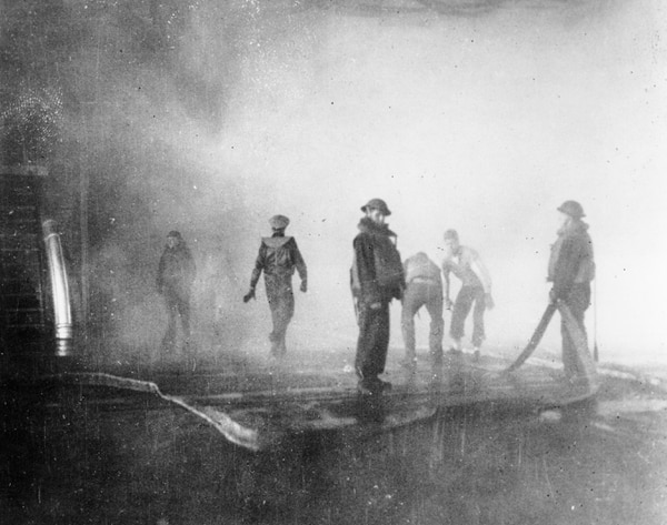 On June 4, 1942, crewmen on board the aircraft carrier Yorktown battle fire after the carrier was hit by Japanese bombs, during the Battle of Midway. (AP)
