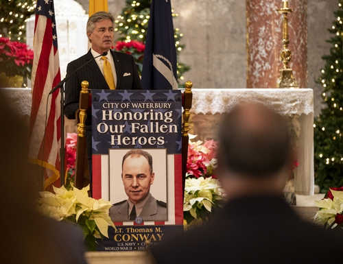 Secretary of the Navy Kenneth J. Braithwaite speaks during a Navy Cross award ceremony for Navy Chaplain Lt. Thomas M. Conway at the Basilica of Immaculate Conception in Waterbury, Conn. The Basilica was Conway's home parish before joining the Navy. (MC2 Alexander C. Kubitza/Navy)