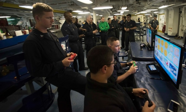Sailors participate in a 2016 video game tournament in the forward mess decks of the aircraft carrierDwight D. Eisenhower. The flagship of the Eisenhower Carrier Strike Group was sailing across the Mediterranean Sea. (Navy)