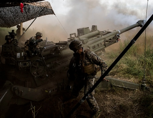 Marines with Bravo Battery, 1st Battalion, 12th Marine Regiment, fire a M777 155 mm howitzer during live-fire training as part of Rim of the Pacific (RIMPAC) exercise at Pohakuloa Training Area, Hawaii, July 17, 2018. (Lance Cpl. Adam Montera/Marine Corps)