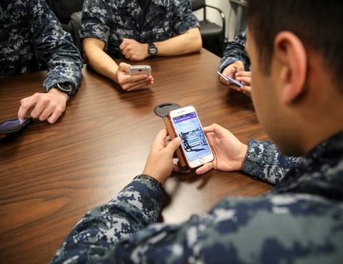 "160127-N-LB724-009 PENSACOLA, Fla. (Jan. 27, 2016) Students from the Aerospace Medical Technician School explore Naval Education Training Command (NETC) smart phone applications to find out more about advancement with the ""FMS Calculator"" and command recourses with ""New to the Navy."" NETC's newest app, NavyCOOL, provides Sailors with a set of credentialing and career tools to help make professional development decisions throughout their Navy career and beyond. Other tools within the app include in-service civilian and industry certifications, road maps to career advancement and retention, and civilian career occupations after life in the Navy. (U.S. Navy photo by Ensign James A. Griffin/Released)."