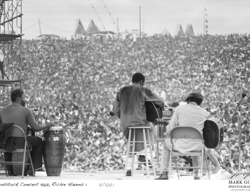This 1969 photo shows Richie Havens as he performs during Woodstock. The photo is only one of hundreds made by photographer Mark Goff who, at the time, worked for an underground newspaper in Milwaukee. (Mark Goff Photography, Leah Demarco/Allison Goff via AP)