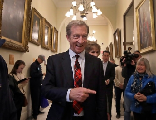 Businessman Tom Steyer walks in the hallway of the New Hampshire Statehouse on Nov. 12, 2019, in Concord, N.H. ((Elise Amendola/AP)