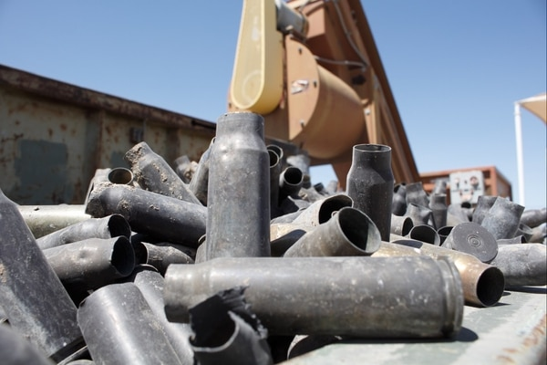 Heaping piles of raw munition materials lie waiting to be sorted at the range residue branch of the recycling center.