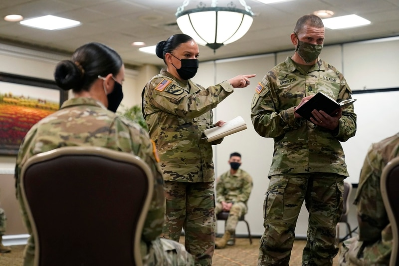 Soldiers give feedback to and Sgt. Maj. Julie Guerra, People First Task Force, center, and Sergeant Major of the Army Michael Grinston, right, about their concerns at Fort Hood, Texas, Thursday, Jan. 7, 2021. (Eric Gay/AP)