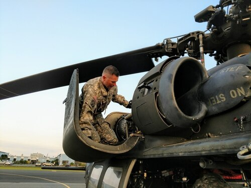 Chief Warrant Officer 2 Kevin Colby conducts pre-flight inspections on his UH-60 Black Hawk helicopter at Long Island MacArthur Airport in Islip, N.Y. The Army on Thursday announced the names of the warrant officers selected for promotion in 2018. (Capt. Mark Getman/New York National Guard)