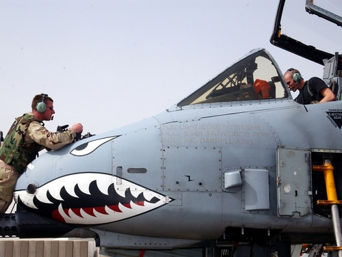 Maintainers work on an A-10 Thunderbolt II at a desert air base in the Arabian Gulf region during Operation Iraqi Freedom.The Air Force has set up a team to look into hypoxia and other unexplained physiological events that have affected pilots flying A-10s and other aircraft. (Master Sgt Stefan Alford/Air Force)