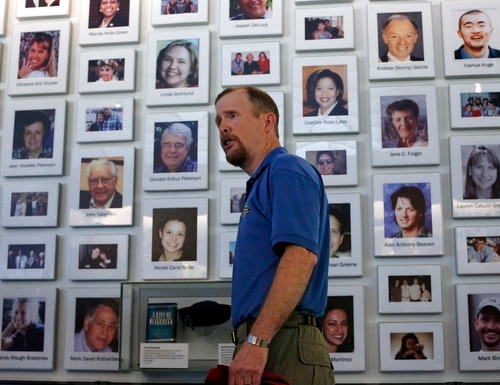 Gordon Felt, whose brother Edward Felt was one of 40 passenger and crew on Uniter Airlines Flight 93 that crashed in a Shanksville, Pa field 14 years ago on Sept. 11, 2001, stands in front of a wall of photos of the 40 crew and passengers who perished in the crash while leading a media tour of the Flight 93 visitors center complex at the Flight 93 National Memorial in Shanksville, Pa, on Wednesday, Sept. 9, 2015. The visitors center will be formally dedicated and open to the public on Sept. 10, 2015. (AP Photo/Gene J. Puskar)