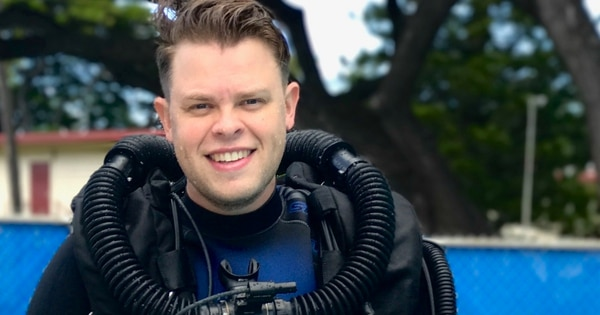 Ensign Brian Bugge had taken up diving with a rebreather shortly after arriving in Hawaii, his wife said. (Courtesy of Ashley Bugge)