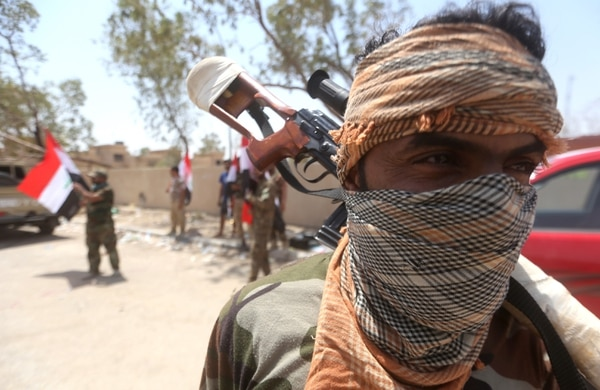An Iraqi Shiite fighter from the Popular Mobilisation units looks on in the town of Saqlawiya on the outskirts of Fallujah, 50kms west of Baghdad, on July 26, 2015. Iraqi government forces gained control over Al-Anbar University from Islamic State (IS) Group, near Ramadi, a key position to reclaim the provincial capital, according to officials. AFP PHOTO/ AHMAD AL-RUBAYE (Photo credit should read AHMAD AL-RUBAYE/AFP/Getty Images)