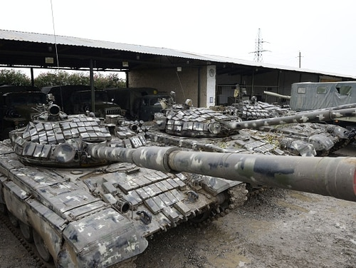 Armenian tanks stand idled in the town of Beylagan on October 5stand idle. Azeri army officials said were seized during the ongoing fighting with Armenia over the breakaway Nagorno-Karabakh region, in the town of Beylagan on October 5, 2020. (Tofik Babayev/AFP via Getty Images)