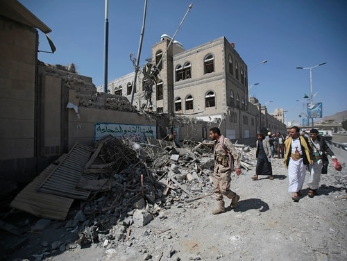 Yemenis inspect the damage after deadly airstrikes in and near the presidential compound in Sanaa, Yemen, May. 7. Airstrikes by the Saudi-led coalition fighting Yemen's Shiite rebels left at least six people dead and some 30 wounded, according to health officials. (Hani Mohammed/AP)