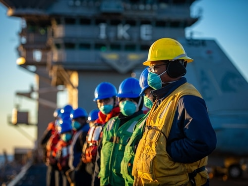 Sailors aboard the aircraft carrier Dwight D. Eisenhower prepare for a replenishment-at-sea on Feb. 4 in the Atlantic Ocean. (Mass Communication Specialist Seaman Apprentice Mo Bourdi/Navy)