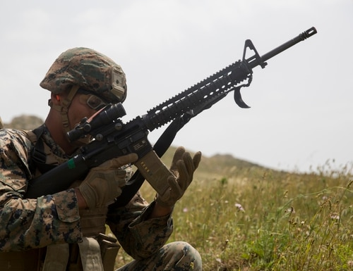 A Marine assigned to Special Purpose Marine Air-Ground Task Force-Crisis Response Africa takes a knee and reloads his M4 carbine during a live-fire and maneuver range at Drasi, Italy, May 2. (Lance Cpl. Taylor W. Cooper/Marine Corps)