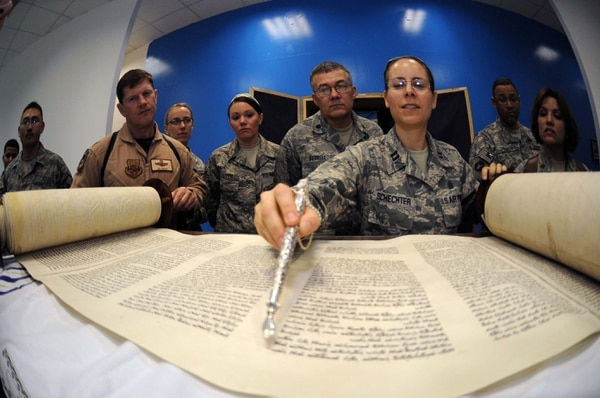 Then-Capt. Sarah Schechter, 332nd Air Expeditionary Wing rabbi, described the newly arrived Torah following a Torah dedication ceremony at Gilbert Memorial Chapel at Iraq's Joint Base Balad on March 21, 2009. (Air Force)