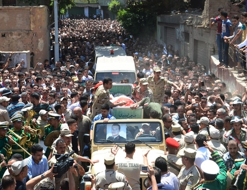 Mourners attend the funeral of Army officer Mustafa el-Wetedi, one of the four Egyptian soldiers who were killed the day before by a roadside bomb in the Sinai Peninsula, on July 24, 2015 at his village of Beshla near Mansura city. The Islamic State group's affiliate in Egypt claimed responsibility for the bombing, in a statement posted on one of its Twitter accounts. AFP PHOTO / STR