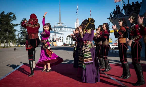 A traditional Georgian dance troupe greets the crew of the guided-missile destroyer Donald Cook in Batum on Monday. (Mass Communication Specialist 2nd Class Ford Williams/Navy)