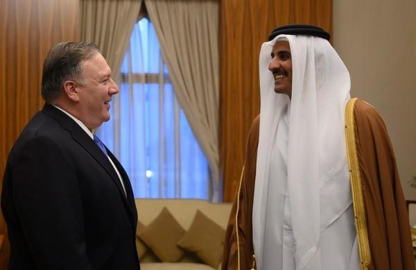 U.S. Secretary of State Mike Pompeo, left, meets with the Qatari Emir Tamim bin Hamad Al Thani, at the Sea Palace, in Doha, Qatar, Sunday, Jan. 13, 2019. (Andrew Caballero-Reynolds/Pool via AP)