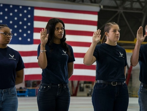 Members of the Air Force Delayed Entry Program take the Oath of Enlistment during Junior ROTC day at Scott Air Force Base, Ill., Nov. 2. The oath is the first step in becoming part of the Air Force and signifies a commitment to serving in the U.S. Armed Forces. (Airman 1st Class Nathaniel Hudson/Air Force)